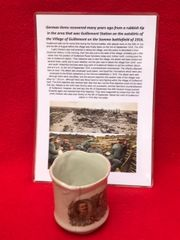 German china mug with picture on recovered many years ago from a rubbish tip in the area that was Guillemont Station on the Somme battlefield of 1916
