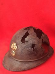 French soldiers M15 Adrian helmet which is in relic but solid condition with leather liner in as found condition recovered from a French Dugout on the september 1916 line on the Verdun battlefield 1916-1918
