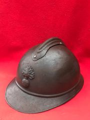 French soldiers M15 Adrian helmet with some original blue paint remains,nice clean condition with badge recovered from the Somme battlefield of 1916-1918