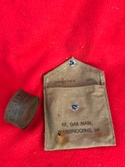 US Soldiers as found together gas mask waterproofing kit bag with wood alcohol fuel tablet tin found in Bastogne many years ago from the fighting in the Ardennes Forest 1944-1945 winter battle