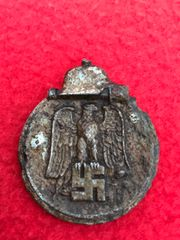 German Eastern Front medal recovered from a large pit of German equipment buried on the Seelow Heights, April 1945 battle the opening battle for Berlin