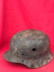 German paratrooper M40 steel helmet with blue paintwork nice condition relic recovered from Fallschirmjager fox holes on Hill 129 the battle of St Lo on the Normandy battlefield of 1944