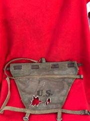 US Soldiers M1928 Doughboy pack haversack pack tail with leather strap found in Bastogne many years ago from the fighting in the Ardennes Forest 1944-1945 winter battle
