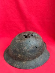 British 1st Pattern Brodie Helmet with paintwork remains recovered many years ago from a British first aid station in Aveluy woods on the 1916 Somme battlefield