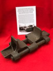 Track Link with pin,nice condition relic from British valentine Tank on lend lease to the Russian Army recovered from the battlefield at Wolomin which was the largest Tank battle fought in Poland in 1944