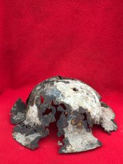 British or Canadian soldiers 1st Pattern Brodie Helmet in relic condition with battle damage recovered in 2016 from Regina Trench near Courcelette on the Somme battlefield of October 1916