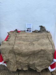 German Army grain sack with eagle,dated 1942 found in the basement of a house near Priekule in the Kurland pocket defended by the SS Nordland Division during the battle with photographs of its recovery in 2018