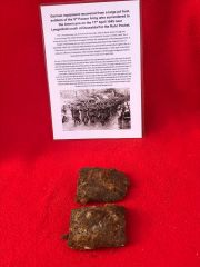 German Army soldiers pair of belt buckles mud covered recovered from a large pit used by soldiers of the 5th Panzer Army who surrendered to the Americans on the 17th April 1945 near Langenfeld south of Dusseldorf in the Ruhr Pocket