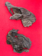 German soldiers gray leather gloves in relic condition recovered from the area where the German 30th infantry division fought near Tilti in the Kurland Pocket the battlefield of 1944-1945