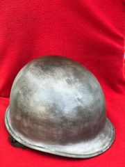 American soldiers M1 helmet with chin straps late 1944-1945 pattern battlefield recovered and overprinted recovered from Koblenz from the battle in March 1945
