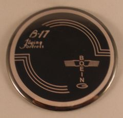 """A lot of 41, 3"""" pin back button modeled after the control yoke hub of a Boeing B-17 Flying Fortress. Made in the USA. BTN-0118-41"""