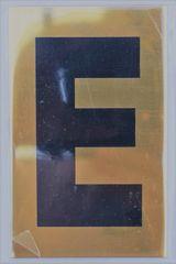 Apartment number sign E – (GOLD ALUMINUM SIGNS 4X2.5)