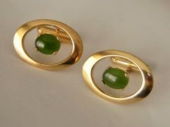 Oval Vintage Cufflinks With A Green Center Stone.