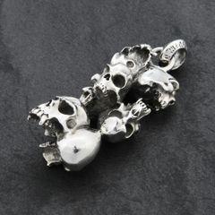 79. 7 Skulls - Sterling Silver Pendant
