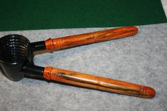 Handcrafted Nutcracker in Black Enamel with Rustic Designed Hand Turned Flame Orange Dyed Box Elder Handles