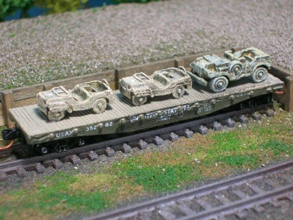 (2) Jeeps and 3/4 Ton Staff Car on US Army Transportation Corp Flat Car