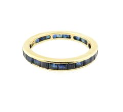 Sapphire and 18k yellow gold eternity band