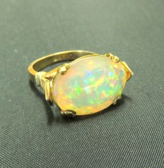Faceted opal in 14k yellow gold ring