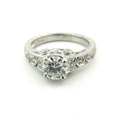 Platinum and diamond engraved ring
