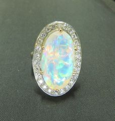 Faceted Opal and diamond ring 14k