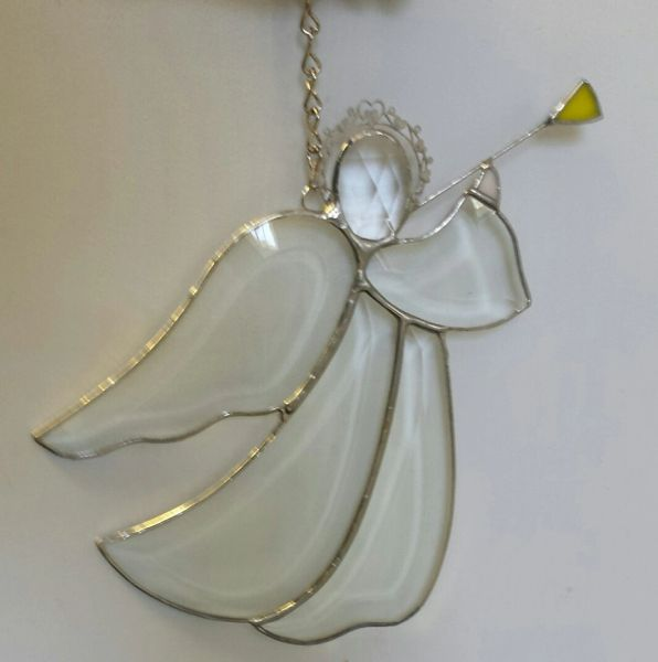 Beveled angel with horn