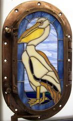 Pelican in porthole