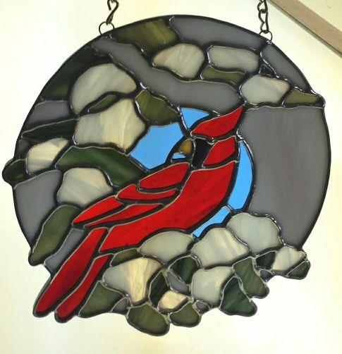 Cardinal and snow circle