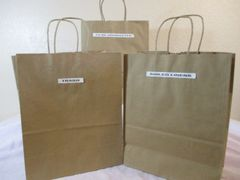 3 labeled standing bags with handles and plastic liners