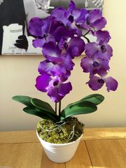 AMAZING REALTOUCH RICH PURPLE ORCHID PLANT ARRANGEMENT WITH LEAVES IN WHITE MATT FINISH CERAMIC PLANTER