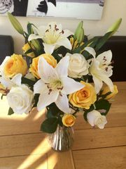 YELLOW ROSE & LILY BOUQUET IN SWIRL VASE WITH WATER