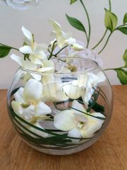 CREAM ORCHID & GRASS ARRANGEMENT, SET IN GLASS BOWL WITH WATER