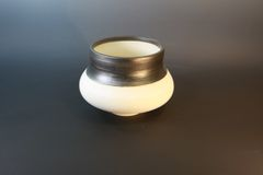 Horse hair bowl with brushed bronze rim.