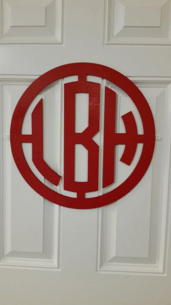 3 letter monogram within a circle frame circle font