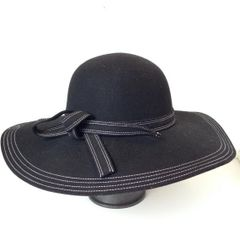 floppy wool hat with white stitching and knotted band detail
