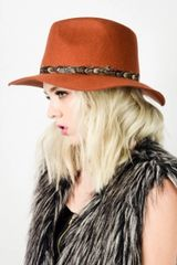 Rust Wool felt panama hat with feather detail