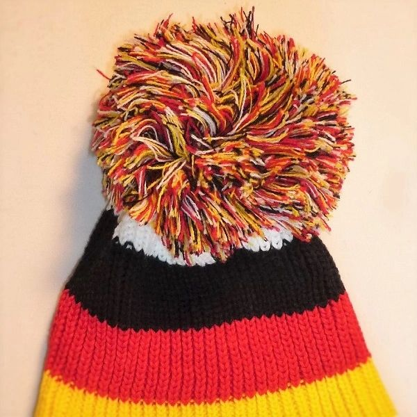 a1146f52 The Flagging German - White Black Red And Yellow Bobble Hat