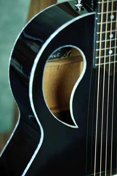 Black Acoustic Guitar With Offset Soundhole And Florentine Cutout