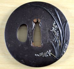 CIRCULAR IRON MIGAKI-JI TSUBA BY HOSO 甫掃 GRASS ORCHID SHAKUDO WITH SILVER & GOLD