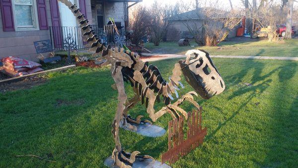 Large steel velociraptor