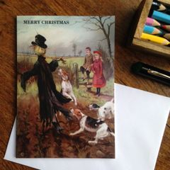 Alternative Vintage Christmas Card Showing Dogs Attacking a Scarecrow! Crikey!