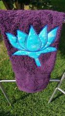 Plum hand towel with Sky Blue Lotus trimmed in Royal Blue