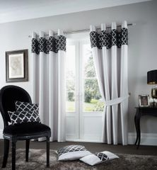 Shiny silver eyelet curtains