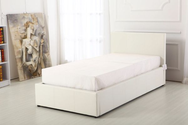 White faux leather ottoman storage bed
