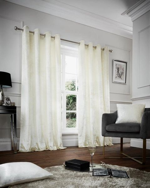 Crushed velvet cream eyelet curtains
