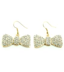 FISH HOOK CRYSTAL PAVE METAL RIBBON THEME EARRINGS. GOLD PLATING / MATERIAL.
