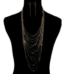 Black and gold metal chain layered necklace set with lobster clasp closure. 19 Inches Long, Gold Plating / Material.