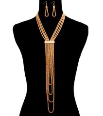Gold metal chain layered drop necklace set with lobster clasp closure. 18 Inches Long.