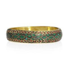 RED AND GREEN ENAMELED BANGLE IN GOLD-TONE. A 10296