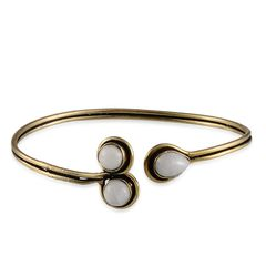 SRI LANKAN WHITE MOONSTONE BANGLE IN GOLD-TONE. A 10484