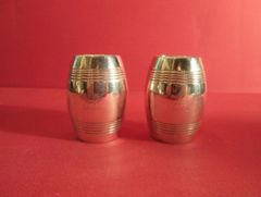 Pair Victorian sterling barrel shakers, with two ban of fluting. Very rare shape, London, 1884.